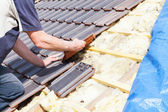 Roofer laying tile on the roof — Stock Photo
