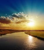 Bright sunset over river with reflections — Stock Photo