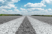 Two solid white lines on asphalt road — Stock Photo
