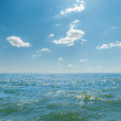 Sea with waves and clouds in blue sky — Stock Photo #59075495