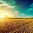 Sunset in dramatic sky over plowed field — Stock Photo #59076713