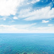 Clouds in blue sky over sea — Stock Photo #60943321