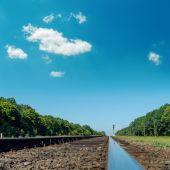 Old railroad closeup under deep blue sky — Stock Photo