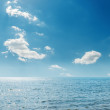 Clouds in blue sky over sea — Stock Photo #69469299