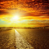 Red sunset and asphalt road — Stock Photo