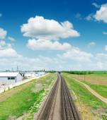 Two railway to horizon in green landscape under blue sky with cl — Stock Photo