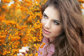 Beautiful young woman portrait, teen girl over autumn yellow par — Stock Photo