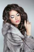 Beautiful brunette Fashion girl in Mink Fur Coat isolated on gra — Stock Photo