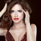 Red lips. Fashion beauty brunette woman model with wavy hair and — Stock Photo