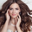 Long blowing hair. Beautiful brunette girl model with makeup, fa — Stock Photo #54897531