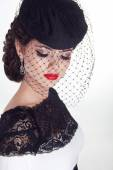 Beautiful brunette retro woman portrait in elegant hat with red — Stock Photo