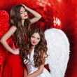 Beautiful attractive ladies with angel wings over disco ball red — Stock Photo #55522973