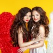 Two Attractive Fashion Women wearing in angel costume with wings — Stock Photo #55607097
