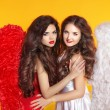 Beautiful Angel girls with angel's wings. Fashion women with lon — Stock Photo #55607099