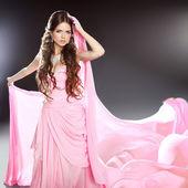 Beautiful brunette girl model in blowing transparent chiffon dre — Stock Photo