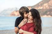 Kissing couple in love outdoors close-up portrait. Man embracing — Stockfoto