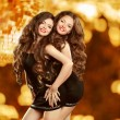 Beautiful attractive laughing two girls dancing over holiday dis — Stock Photo #67611485