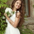 Outdoor Portrait Of Beautiful Happy Bride with long wavy hair in — Stock Photo #71535013