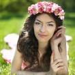 Beauty Romantic Girl Outdoors. Attractive teen with flowers on h — Stock Photo #73647567