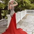 Fashion elegant blond woman model in red gown with long train of — Stock Photo #74054425