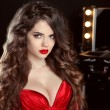 Long wavy hair. Beautiful brunette girl with red lips in sensual — Stock Photo #74605715