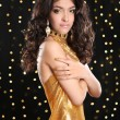 Fashion brunette girl in golden dress with Long curly hair, beau — Stock Photo #75753539