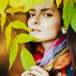 Brunette in yellow leaves — Stock Photo #54517649
