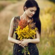 Brunette with flowers — Stock Photo #71276613