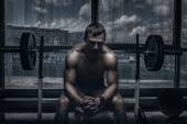 Athlete in old rusty gym — Stock Photo
