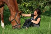 Woman and horse resting at the grazing — Stock Photo