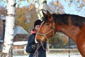 Beautiful teenager girl and bay horse portrait in autumn — Stock Photo