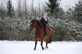Teenager girl riding horse without saddle and bridle — Stock Photo