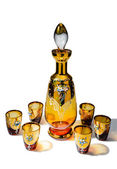 The set of decanter and six shot glasses for spirits — Stock Photo