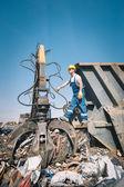 Worker in a junkyard — Stock Photo