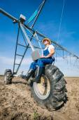 Farmer on irrigation systems — Foto de Stock