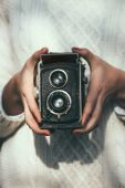 Young woman with a retro camera — Stock Photo