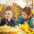Child lying on the golden leaf — Stock Photo #58242197