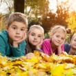 Child lying on the golden leaf — Stock Photo #58252627