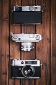 Vintage camera on wooden background — Stock Photo