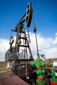 Work of oil pump jack on a oil field — Stock Photo