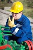 Worker on the oil field — Stock Photo