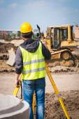 Surveyor engineer worker making measuring with theodolite tool equipment at construction site — Stock Photo