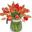 Bouquet of red tulips in a jug on a white background, macro. — Stock Photo #63626601