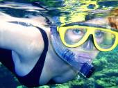 The girl in a mask with a tube under water (snorkeling). — Stock Photo