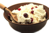 Fresh curd with a cranberry — Stock Photo