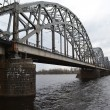 Railway bridge across the Daugava river. — Stock Photo #71086715