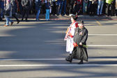 Russian Cossack and Orthodox priest on Victory parade. — Stock Photo