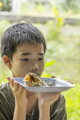 Pensive boy looks at fish bone eaten clearly on plate — Stock Photo