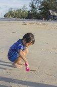 Asian Thai little boy playing sand — Stock Photo
