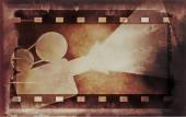 Old grunge film strip and movie projector — Stock Photo